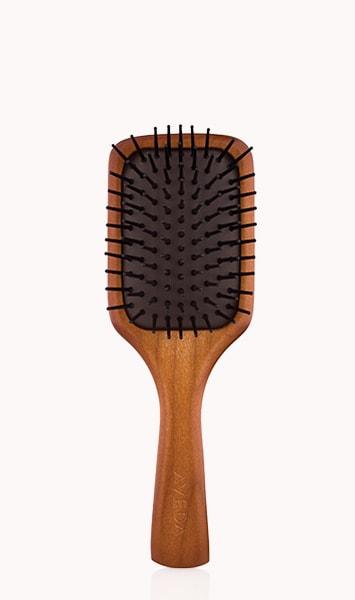 petite brosse plate en bois aveda